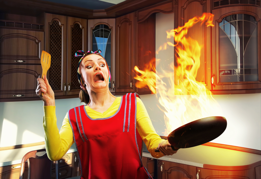 Housewife cooking in the kitchen with big fire