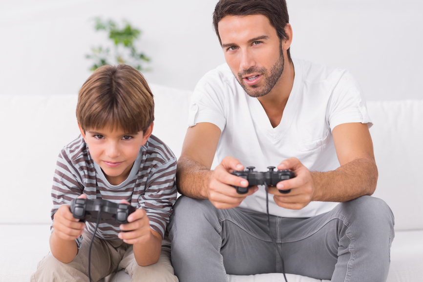 dad and child playing video games