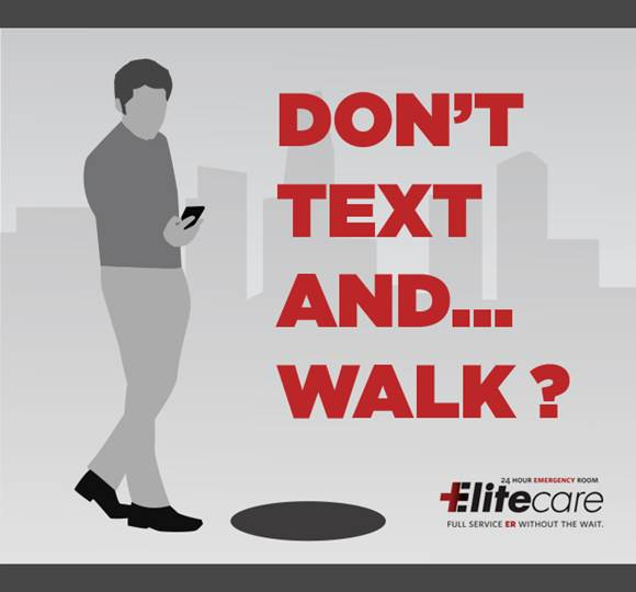 Man Texting and Walking